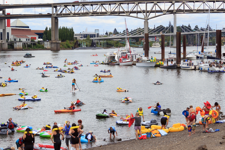 floaters: Portland, Oregon, USA - July 26, 2015: Floaters enjoy the coast down the Wiallamette RIver during The Big Float 2015