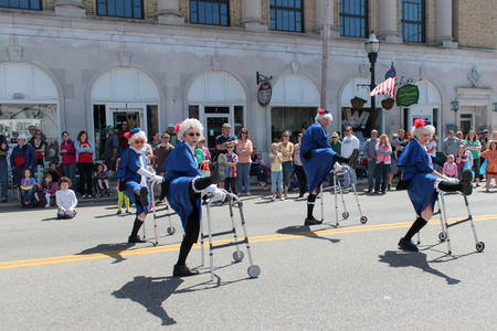 chagrin: Chagrin Falls, Ohio, USA - May 26th, 2013:  Dressed in old women drag, these dancing grandmas dance down the street with their walkers at the  Blossom Time Parade, Chagrin Falls, Ohio