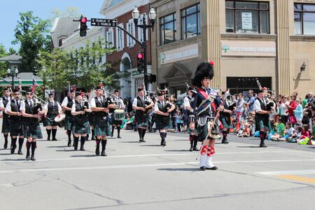 chagrin: Chagrin Falls, Ohio, USA - May 26th, 2013:  The bagpipers march down the street helping begin the  Blossom Time Parade, Chagrin Falls, Ohio