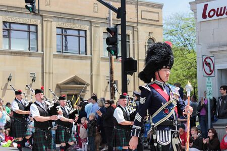 blossom time: Chagrin Falls, Ohio, USA - May 26th, 2013:  The bagpipers march down the street helping begin the  Blossom Time Parade, Chagrin Falls, Ohio