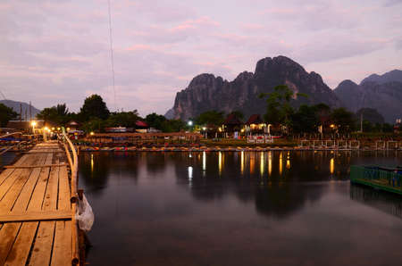 Wooden bridge over the Song River to Vang Vieng community