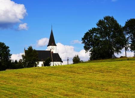 Village church Reklamní fotografie