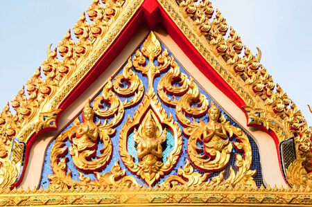 ornately: detail of ornately decorated temple roof in Pattani, thailand.