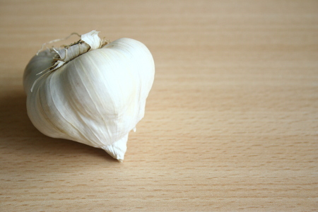 Garlic on brown background closeup photo