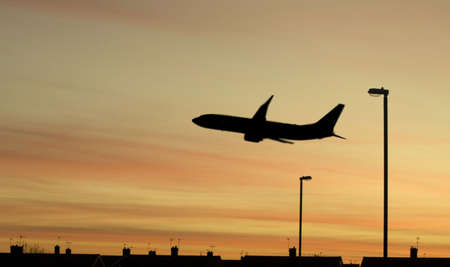 Silhouette of a jet plane shortly after take-off Stock Photo