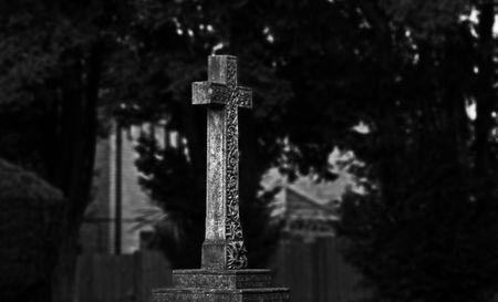 Monochrome image of a cross memorial