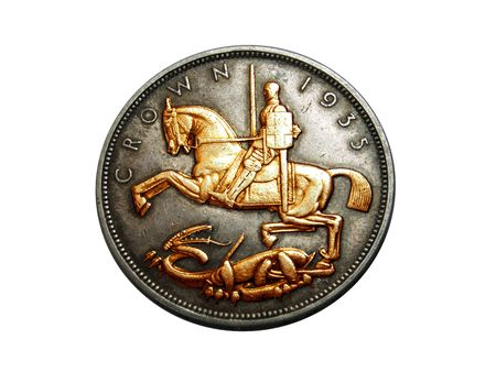 Reverse side of an old English coin showing St George and the dragon in gold