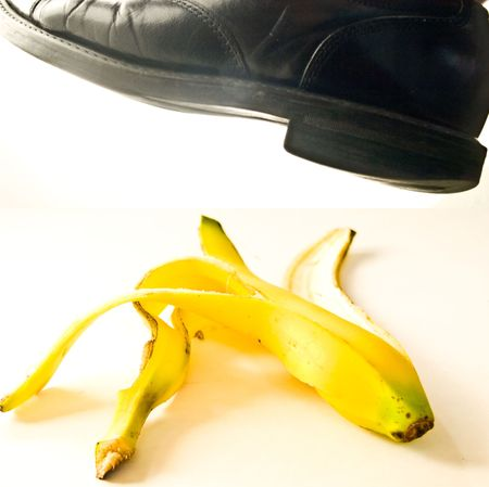 Concept image of a foot about to step on a banana skin