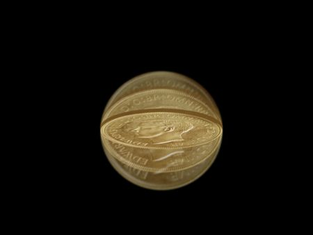 Flipped coin isolated in motion against a black background
