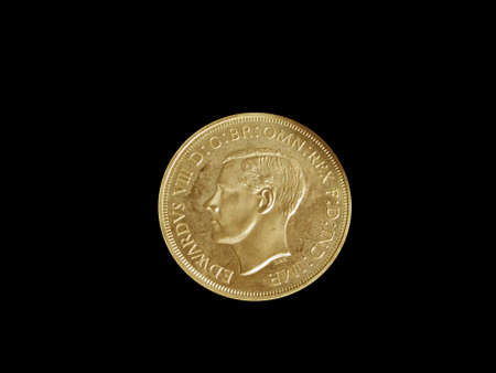 King Edward VIII coin isolated on a black background