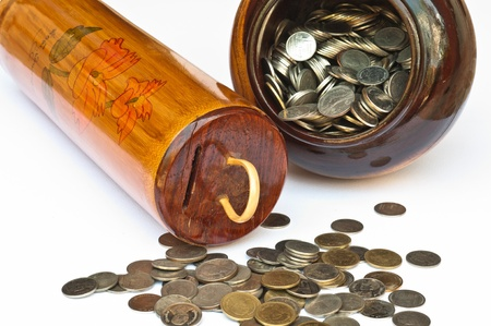 money coin savings in bamboo and  jars photo