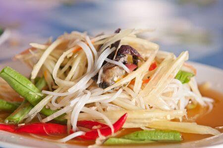Thai style papaya salad with crab salty food photo