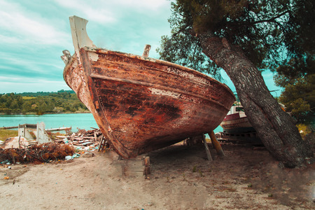 old wooden boat for reparation photo