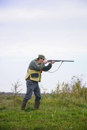 cull: Hunter was preparing to cull birds Stock Photo