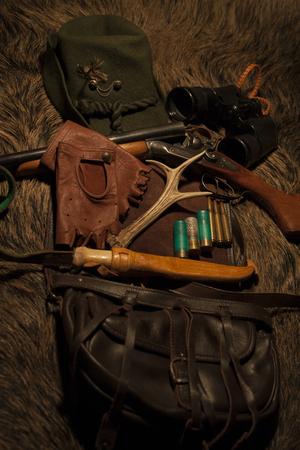 wildlife shooting: Equipment for hunting on wild boar skin Stock Photo