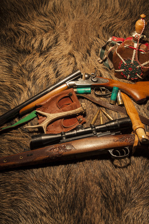 wildlife shooting: Equipment for hunting on wild boar skin Stock Photo