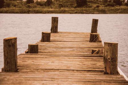 boat dock: Wooden Boat dock  jetty