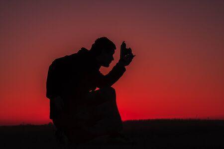 Men with binoculars watching a beautiful sunset Reklamní fotografie