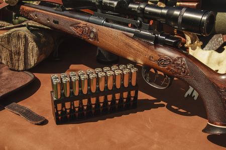 hunting: rifle with ammunition