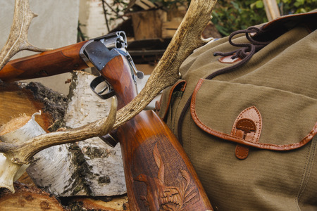 Hunting rifle,knife and horn