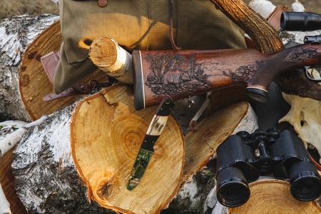 On the wood rifle, knife and binocular Reklamní fotografie