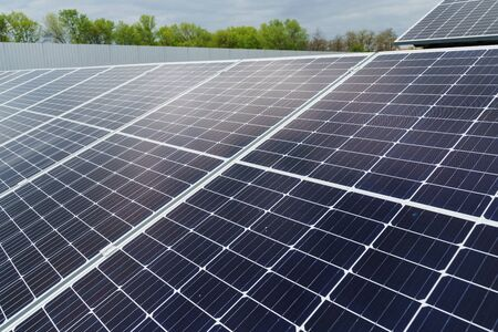 Sun solar panels electricity sustainability of planet. Green energy for home. Solar cells power plant business. Ecological clean energy. Blue panels on the ground. Banco de Imagens