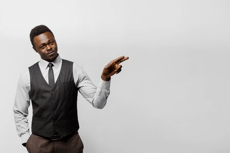 Black african business man points to right side empty for adver text. You can change your life. Successful people lifestyle advert. You can win a prize in online bet. Man separete white background