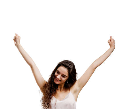 Winning happy girl puts hands up and smile. Young smiley woman celebrates victory in on-line game. Advert for on line business Standard-Bild