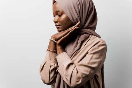 Black woman pray in god. Religious girl on white background. Islamic religion