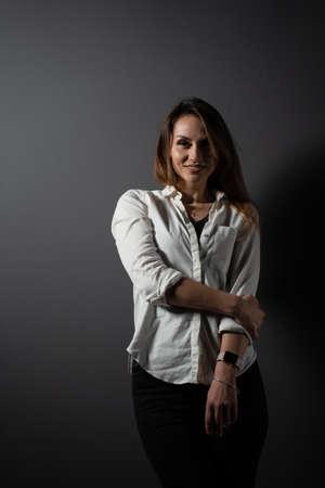 Business woman portrait on black background. Confident model posing. Lifestyle Stockfoto