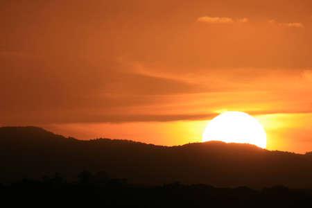 exultation: Landscape silhouette of a sunset behind mountains