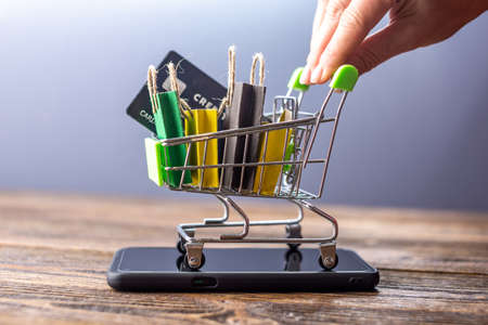 paper shop bags on mobile phone for concept shopping online and technology