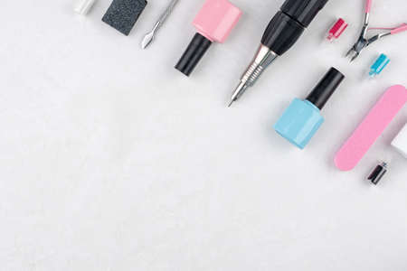 Tools and accessories for manicure and pedicure procedures on a white background. Copy space.