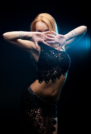 Beautiful woman is dancing the oriental dance photo