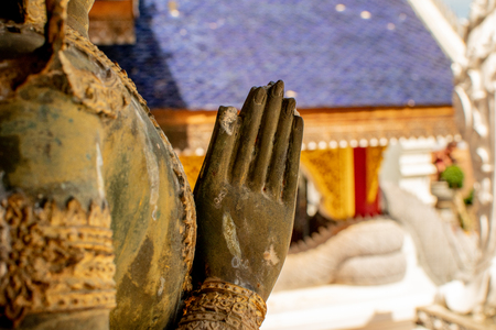The hand of the old statue is inside the temple. 版權商用圖片