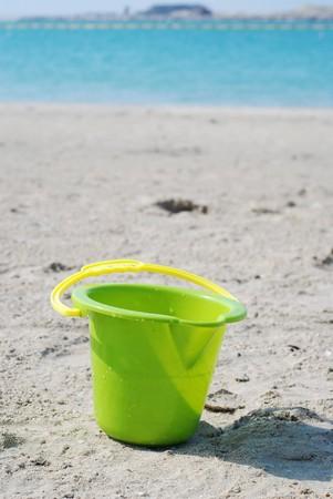toy bucket on beach
