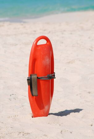 buoyancy: Lifeguard buoyancy aid sticking in the sand Stock Photo