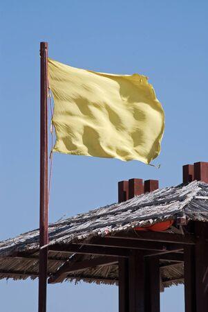 tremble: Yellow flag on beach