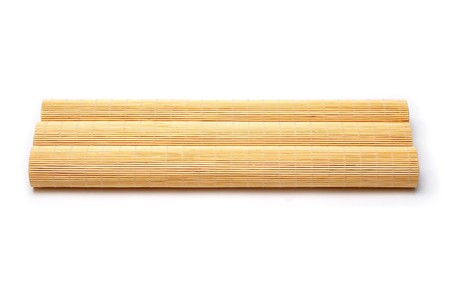 bamboo stick sushi pads isolated on a white background Stock Photo
