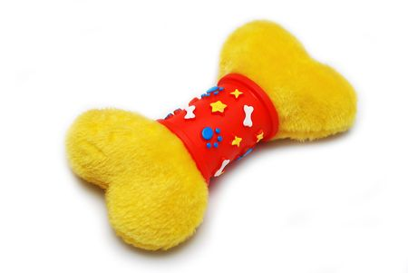 Soft yellow bone toy for dog isolated on a white background