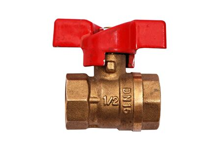 Brass Valve with red handle isolated on a white background Stock Photo