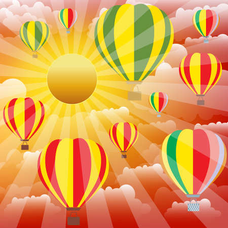 Aerostat balloons over sunset sky.