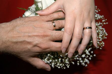 wedding rings on a bouquet Stock Photo - 13024443