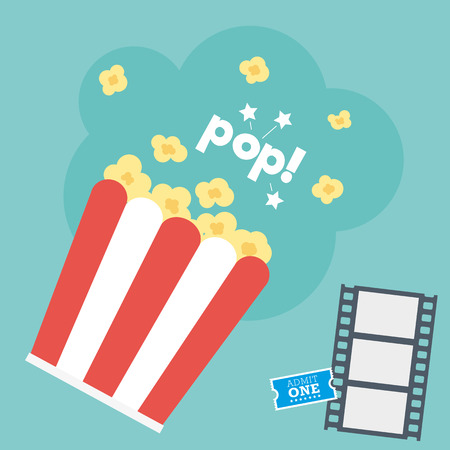 Popcorn in a carton with movie ticket and film