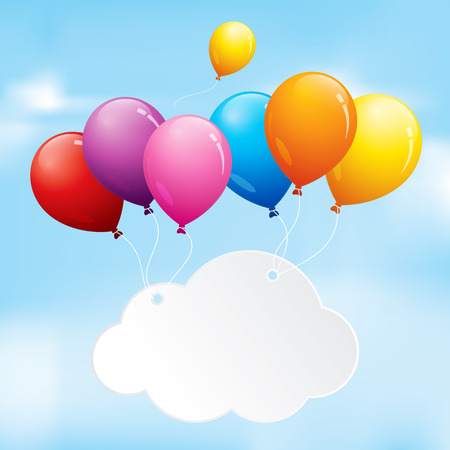 Colourful balloons floating in a cloudy sky