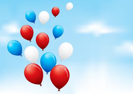 曇り空に浮かぶ赤、白および青の風船