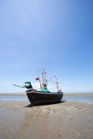 aground: wooden boat aground on the beach