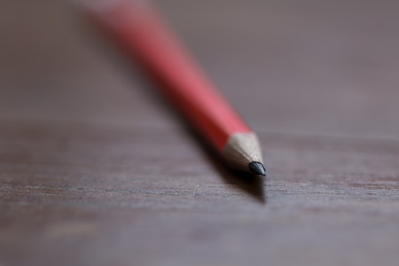 dept: a pencil on wooden table in macro with extreamely dept of field Stock Photo