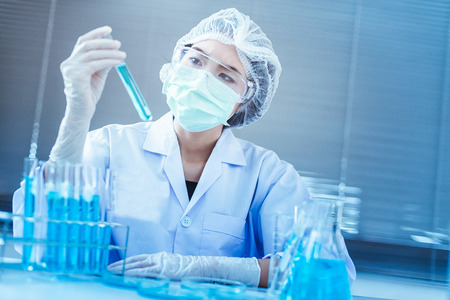 Beautiful asian woman scientist with test tube making research in clinical laboratory.Science, chemistry, technology, biology and people concept Stock Photo