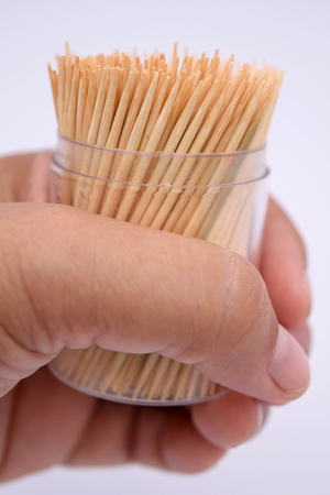 loss leader: Toothpick in hand. Stock Photo